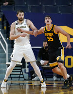Michigan center Hunter Dickinson (1) goes up against Iowa center Luka Garza (55) during the first half of an NCAA college basketball game, Thursday, Feb. 25, 2021, in Ann Arbor, Mich. (AP Photo/Carlos Osorio)