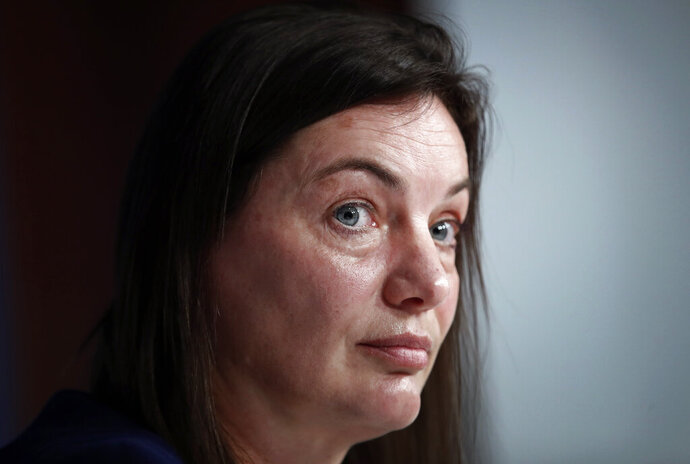 FILE - In this Wednesday, Feb. 20, 2019 file photo, France women's soccer head coach Corinne Diacre during a press conference in Paris. With an experienced side featuring seven players from the Lyon side which recently won the Champions League for the fourth straight year, host France will be among the favorites for the Women's World Cup, and this suits coach Corinne Diacre just fine.  (AP Photo/Christophe Ena, File)