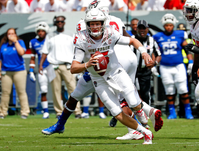 FILE - In this Sept. 8, 2018, file photo, North Carolina State quarterback Ryan Finley (15) rolls out during the first half of the team's NCAA college football game against Georgia State in Raleigh, N.C. Finley has helped the Wolfpack rank third nationally in third-down conversion rate entering Saturday's game against Boston College. (AP Photo/Chris Seward)