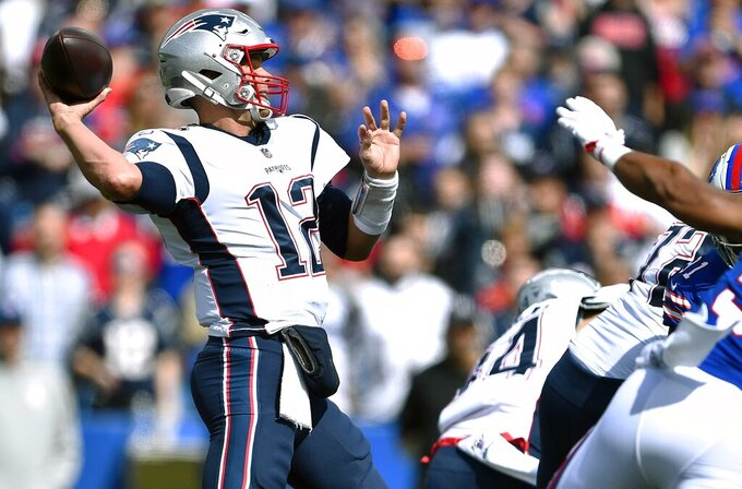 New England Patriots quarterback Tom Brady drops back to pass against the Buffalo Bills in the first half of an NFL football game, Sunday, Sept. 29, 2019, in Orchard Park, N.Y. (AP Photo/Adrian Kraus)