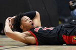 Louisville forward Dwayne Sutton (24) reacts after being called for a foul against Western Kentucky during the first half of an NCAA college basketball game Friday, Nov. 29, 2019, in Nashville, Tenn. (AP Photo/Mark Zaleski)