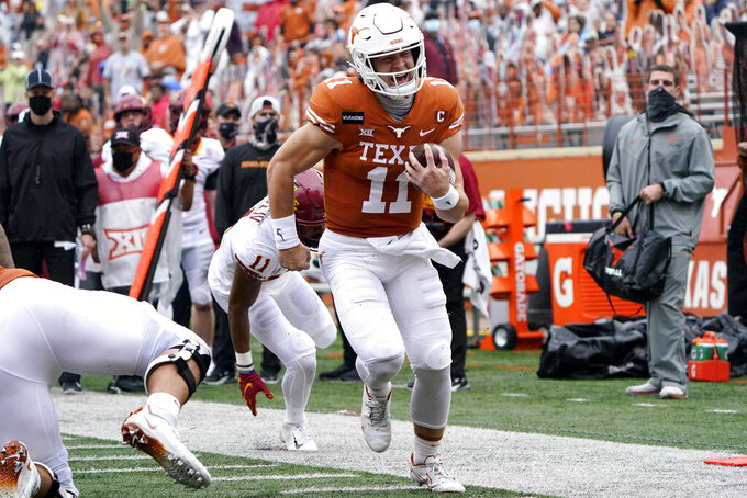 Texas quarterback Sam Ehlinger (11) runs for a 17-yard touchdown against Iowa State during the first half of an NCAA college football game, Friday, Nov. 27, 2020, in Austin, Texas. (AP Photo/Eric Gay)