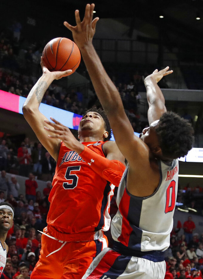 Auburn forward Chuma Okeke (5) shoots as Mississippi guard Blake Hinson (0) defends during the first half of an NCAA college basketball game Wednesday, Jan. 9, 2019, in Oxford, Miss. (AP Photo/Rogelio V. Solis)