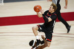 Texas Tech guard Mac McClung, top, is fouled by Iowa State guard Tre Jackson while driving to the basket during the first half of an NCAA college basketball game, Saturday, Jan. 9, 2021, in Ames, Iowa. (AP Photo/Charlie Neibergall)