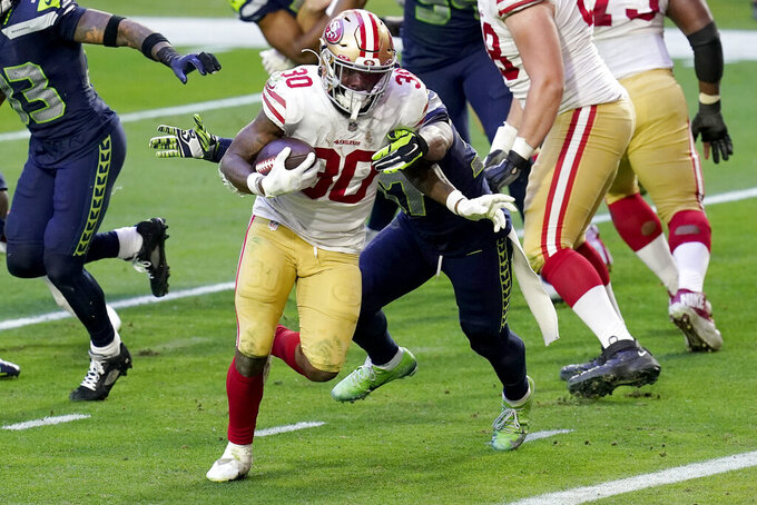 San Francisco 49ers running back Jeff Wilson (30) runs for a touchdown against the Seattle Seahawks during the second half of an NFL football game, Sunday, Jan. 3, 2021, in Glendale, Ariz. (AP Photo/Ross D. Franklin)