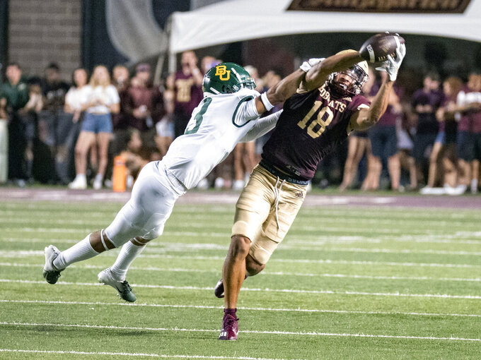 Texas State receiver Marcell Barbee, right, makes a catch against Baylor cornerback Kordell Rodgers during the second half of an NCAA college football game Saturday, Sept. 4, 2021, in San Marcos, Texas. Baylor won 29-20. (AP Photo/Michael Thomas)