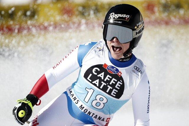 Switzerland's Lara Gut-Behrami celebrates at the finish area of an alpine ski, women's World Cup downhill, in Crans Montana, Switzerland, Friday, Feb. 21, 2020. (AP Photo/Gabriele Facciotti)