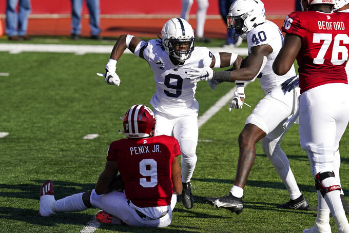 Penn State's Joey Porter Jr. (9) celebrates a sack of Indiana quarterback Michael Penix Jr. (9) during the first half of an NCCAA college football game, Saturday, Oct. 24, 2020, in Bloomington, Ind. (AP Photo/Darron Cummings)
