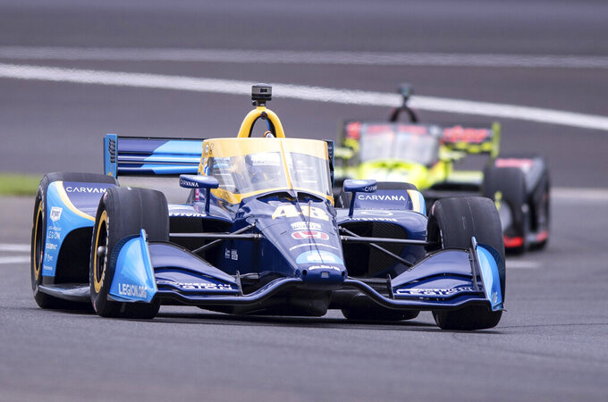 Jimmie Johnson drives along the course during a practice session for the IndyCar auto race at Indianapolis Motor Speedway, Friday, Aug. 13, 2021, in Indianapolis. (AP Photo/Doug McSchooler)