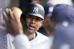 New York Yankees' Aaron Hicks is congratulated by teammates after hitting a solo home run in the fifth inning of a baseball game against the Cleveland Indians, Saturday, April 24, 2021, in Cleveland. (AP Photo/Tony Dejak)