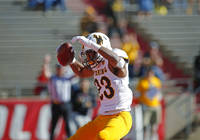Wyoming running back Xazavian Valladay (23) celebrates after scoring a touchdown against New Mexico during the first half of an NCAA college football game in Albuquerque, N.M., Saturday, Nov. 24, 2018. (AP Photo/Andres Leighton)