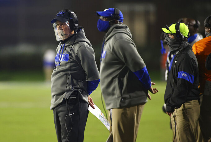 Duke coach David Cutcliffe stands on the sideline while wearing a face shield during the second half of the team's NCAA college football game against Charlotte on Saturday, Oct. 31, 2020, in Durham, N.C. (Jaylynn Nash/Pool Photo via AP)