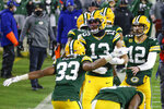 Green Bay Packers' Allen Lazard (13) celebrates after scoring a 58-yard touchdown during the second half of an NFL divisional playoff football game against the Los Angeles Rams Saturday, Jan. 16, 2021, in Green Bay, Wis. (AP Photo/Matt Ludtke)