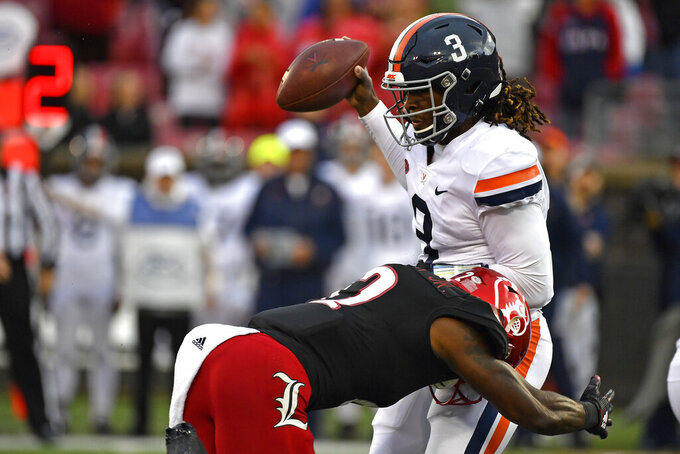Virginia quarterback Bryce Perkins (3) is sacked by Louisville defensive back Marlon Character (12) during the second half of an NCAA college football game in Louisville, Ky., Saturday, Oct. 26, 2019. (AP Photo/Timothy D. Easley)