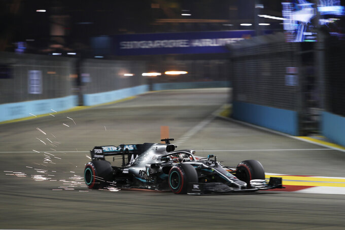 Mercedes driver Lewis Hamilton of Britain steers his car during the qualifying round for the Singapore Formula One Grand Prix at the Marina Bay City Circuit in Singapore, Saturday, Sept. 21, 2019. (AP Photo/Vincent Thian)