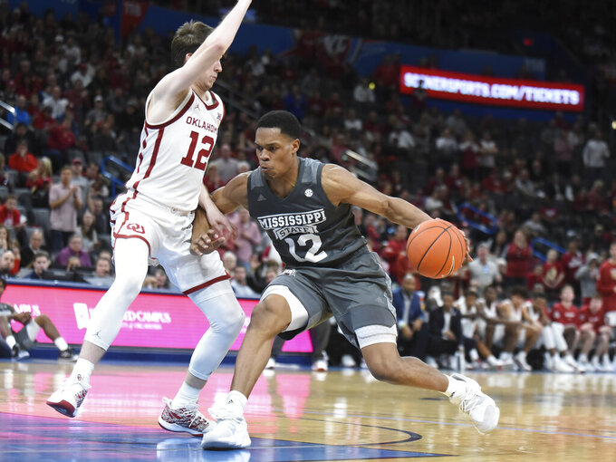 Mississippi State guard Robert Woodard (12) tries to push past Oklahoma guard Austin Reaves (12) during the second half of an NCAA college basketball game in Oklahoma City, Saturday, Jan. 25, 2020. (AP Photo/Kyle Phillips)