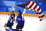 FILE - In this Feb. 22, 2018, file photo, United States' Kendall Coyne Schofield, left, and Hilary Knight celebrate after winning the women's gold medal hockey game against Canada at the 2018 Winter Olympics in Gangneung, South Korea. Growing up, Coyne Schofield recalled how her dreams of playing hockey ended at college, or maybe the Winter Games _ something the two-time U.S. Olympian forward would eventually achieve. Coyne Schofield and more than 200 of some of the world's top female players who have pledged to not compete in North America this season are determined to change that notion. (AP Photo/Jae C. Hong, File)