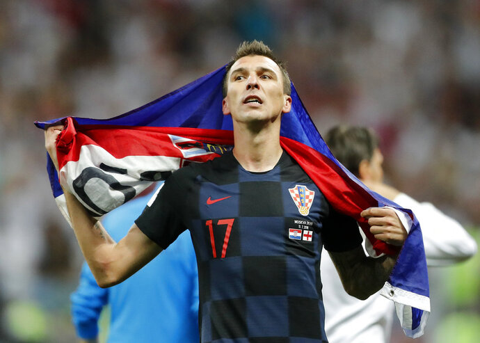 Croatia's Mario Mandzukic celebrates after his team advanced to the final during the semifinal match between Croatia and England at the 2018 soccer World Cup in the Luzhniki Stadium in Moscow, Russia, Wednesday, July 11, 2018. (AP Photo/Frank Augstein)