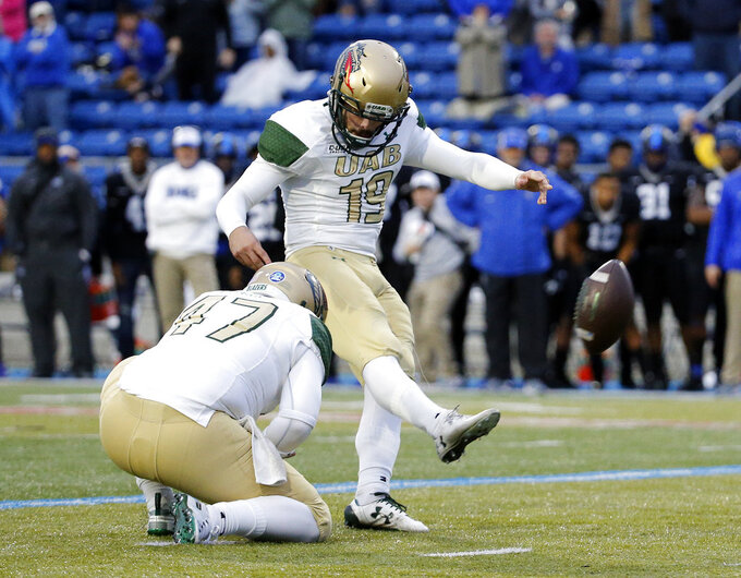 UAB place kicker Nick Vogel (19) makes a winning 28-yard field goal against Middle Tennessee in the fourth quarter of the NCAA Conference USA championship college football game Saturday, Dec. 1, 2018, in Murfreesboro, Tenn. UAB's Jacob Clark (47) holds. (AP Photo/Mark Humphrey)