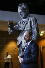 Martin Schulz announces his resignation as Social Democratic Party, SPD, chairman at the party's headquarters in Berlin, Tuesday, Feb. 13, 2018. In the background a statue of former SPD leader and German Chancellor Willy Brandt. (AP Photo/Markus Schreiber)