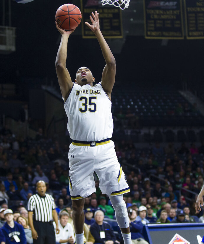 Notre Dame's Bonzie Colson (35) puts up a shot against Hampton during an NCAA college basketball game in the first round of the NIT tournament, Tuesday, March 13, 2018, in South Bend, Ind.   (Michael Caterina/South Bend Tribune via AP)