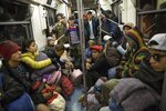 Central American migrants ride on the subway after leaving the temporary shelter at the Jesus Martinez stadium, in Mexico City, Friday, Nov. 9, 2018. About 500 Central American migrants headed out of Mexico City on Friday to embark on the longest and most dangerous leg of their journey to the U.S. border, while thousands more were waiting one day more at the stadium. (AP Photo/Rodrigo Abd)