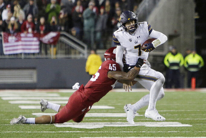 Washington State defensive lineman Logan Tago (45) tackles California quarterback Chase Garbers (7) during the second half of an NCAA college football game in Pullman, Wash., Saturday, Nov. 3, 2018. Washington State won 19-13. (AP Photo/Young Kwak)