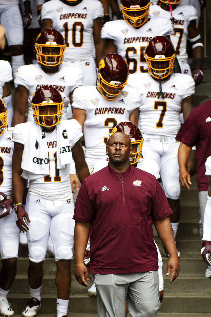 Central Michigan assistant head coach Tim Skipper leads his team to the field prior to an NCAA college football game against Missouri, Saturday, Sept. 4, 2021, in Columbia, Mo. Skipper is replacing head coach Jim McElwain who did not make the trip.(AP Photo/L.G. Patterson)
