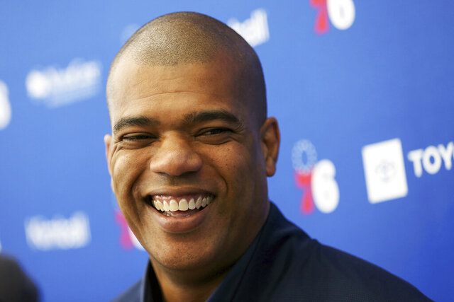 Philadelphia 76ers NBA basketball team executive Marc Eversley smiles while talking to reporters during a pre-draft workout at the Sixers Training Complex in Camden, N.J., Thursday, June 13, 2019. The Chicago Bulls have agreed to a deal with Philadelphia 76ers executive Marc Eversley to replace the fired Gar Forman as general manager and work under new top basketball executive Arturas Karnisovas, a person familiar with the situation said on Monday, April 27, 2020. The person spoke on the condition of anonymity because the move hadn't been announced. (Tim Tai/The Philadelphia Inquirer via AP)