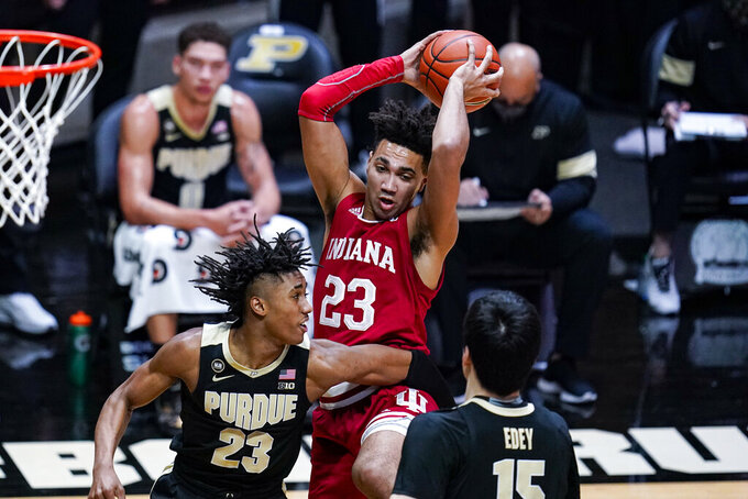 FILE - Indiana forward Trayce Jackson-Davis (23) grabs a rebound over Purdue guard Jaden Ivey (23) during the first half of an NCAA college basketball game in West Lafayette, Ind., in this Saturday, March 6, 2021, file photo. Jackson-Davis is a member of The AP All-Big Ten first  team, announced Tuesday, March 9, 2021. (AP Photo/Michael Conroy, File)
