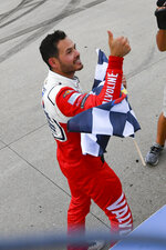 Kyle Larson gives a thumbs-up to fans after taking the checkered flag for winning a NASCAR Cup Series auto race Sunday, June 20, 2021, in Lebanon, Tenn. (AP Photo/John Amis)
