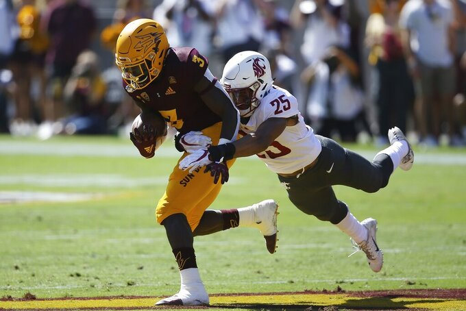 Arizona State running back Eno Benjamin (3) is pulled down by Washington State safety Skyler Thomas (25) during the first half of an NCAA college football game Saturday, Oct. 12, 2019, in Tempe, Ariz. (AP Photo/Ross D. Franklin)