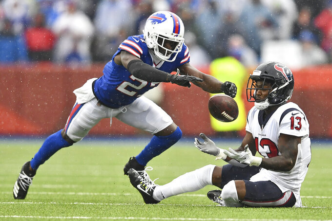 Houston Texans wide receiver Brandin Cooks (13) catches a pass under pressure from Buffalo Bills cornerback Tre'Davious White (27) during the second half of an NFL football game, Sunday, Oct. 3, 2021, in Orchard Park, N.Y. (AP Photo/Adrian Kraus)