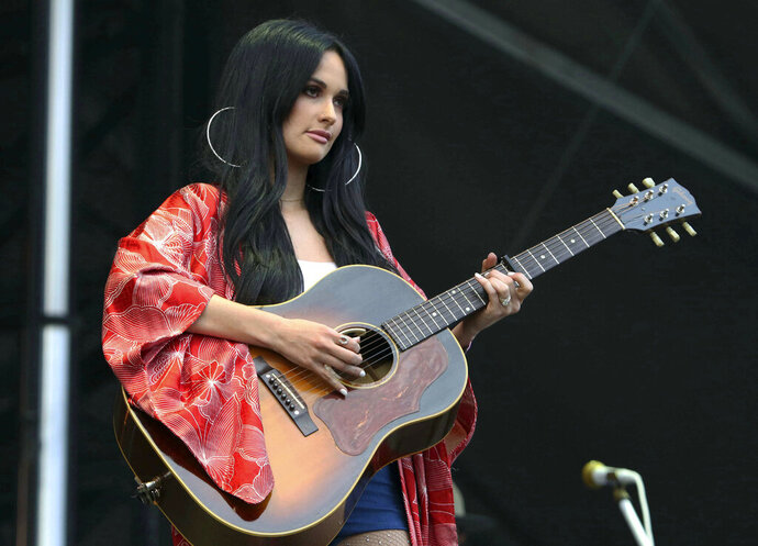 "FILE - In this Sept. 15, 2018 file photo, Kacey Musgraves performs during Music MidTown 2018 at Piedmont Park, in Atlanta. Chris Stapleton, Dan + Shay lead the 54th Academy of Country Music Awards with six nominations each while Grammy album of the year winner Musgraves comes in with five nominations. Reba McEntire, who is hosting the show for a record 16th time, announced the nominees in top categories on ""CBS This Morning"" on Wednesday, Feb. 20, 2019. (Photo by Katie Darby/Invision/AP, File)"
