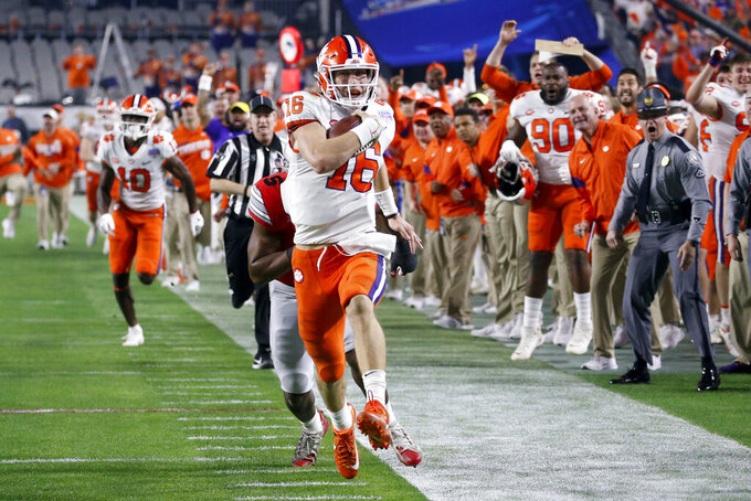 FILE - Clemson quarterback Trevor Lawrence runs for a touchdown against Ohio State during the first half of the Fiesta Bowl NCAA college football playoff semifinal in Glendale, Ariz., Saturday, Dec. 28, 2019, in Glendale, Ariz. Lawrence is widely considered the best quarterback prospect to come out of college since Andrew Luck nearly a decade ago. (AP Photo/Ross D. Franklin)