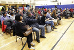 FILE- In this Thursday, March 7, 2019 photo, residents of the Queensbridge Houses listen during a community town hall called by HUD executive Lynne Patton in New York. Patton, who spent a month living in four public housing complexes, called the meeting to discuss residents' needs, monitor oversight and learn how things can be improved. (AP Photo/Kathy Willens, File)