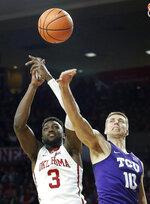Oklahoma's Khadeem Lattin (3) and TCU's Vladimir Brodziansky (10) fight for the rebound during the first half of an NCAA college basketball game in Norman, Okla., Saturday, Jan. 13, 2018. (AP Photo/Garett Fisbeck)
