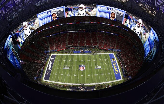 Players warm ahead of the NFL Super Bowl 53 football game between the Los Angeles Rams and the New England Patriots, Sunday, Feb. 3, 2019, in Atlanta. (AP Photo/Morry Gash)