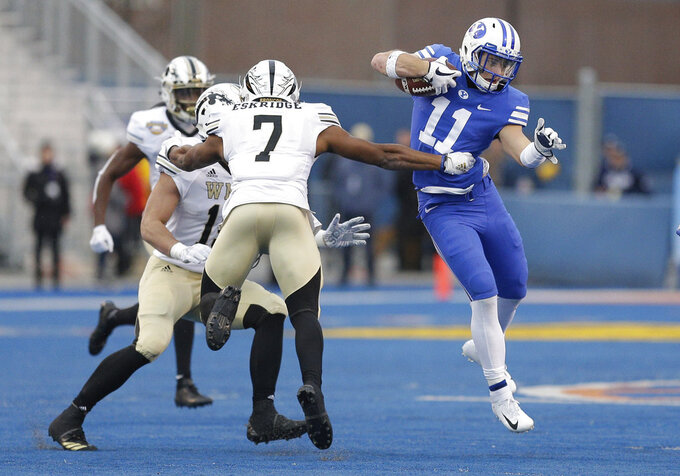 BYU defensive back Austin Lee (11) tries to get past Western Michigan linebacker Najee Clayton (7) during an interception return in the second half of the Famous Idaho Potato Bowl NCAA college football game, Friday, Dec. 21, 2018, in Boise, Idaho. (AP Photo/Steve Conner)