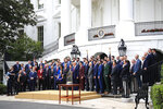 President Donald Trump, center, joins the Boston Red Sox for a group picture during a ceremony honoring the 2018 World Series baseball champion to the White House in Washington, Thursday, May 9, 2019. (AP Photo/Manuel Balce Ceneta)