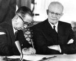 Japanese Prime Minister Nobusuke Kishi signs a treaty of mutual security with the United States on Jan. 19, 1960 in Washington. President Dwight D. Eisenhower witnesses the signing. (AP Photo)