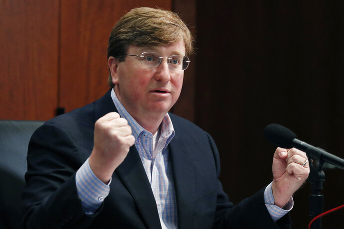 Republican Gov. Tate Reeves gestures Monday, May 4, 2020, in Jackson, Miss., as he wonders how needy state residents are being helped when lawmakers passed a bill May 1, that takes control of the federal CARES Act money, during his daily update on the state's response to COVID-19.   (AP Photo/Rogelio V. Solis)