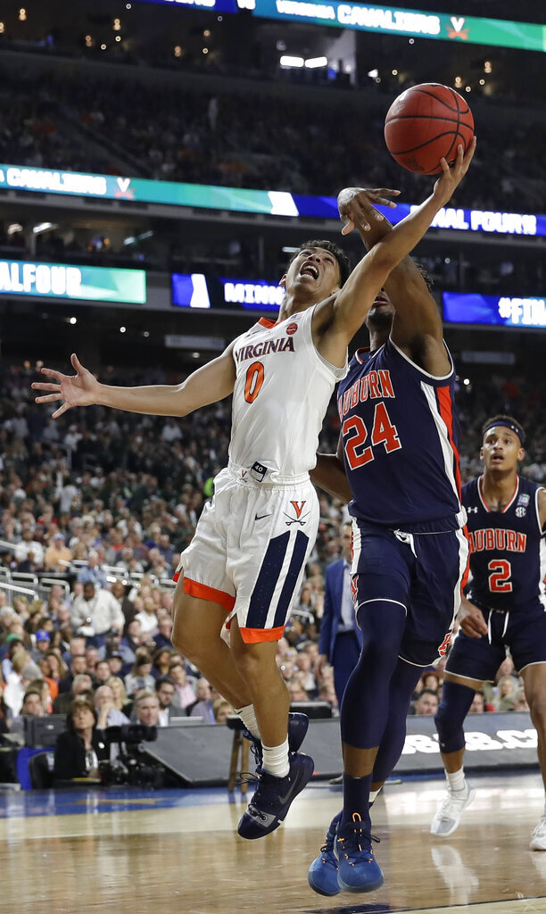 Virginia guard Kihei Clark (0) drives to the basket ahead of Auburn forward Anfernee McLemore (24) during the second half in the semifinals of the Final Four NCAA college basketball tournament, Saturday, April 6, 2019, in Minneapolis. (AP Photo/David J. Phillip)
