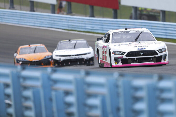 NAustin Cindric (22) leads the pack driving up the esses in the first stage of a NASCAR Xfinity Series auto race at Watkins Glen International in Watkins Glen, N.Y., Saturday, Aug. 7, 2021. (AP Photo/Joshua Bessex)