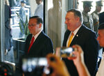 U.S. State Secretary Mike Pompeo, right, arrives for his bilateral meeting with Philippine Foreign Affairs Secretary Teodoro Locsin Jr., left, in suburban Pasay city southeast of Manila, Philippines Friday, March 1, 2019. Pompeo, who joined U.S. President Donald Trump in the second summit with North Korean leader Kim Jong-un in Vietnam, is here for talks on the two countries' relations as well as the mutual defense treaty. (AP Photo/Bullit Marquez)