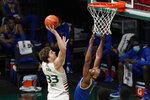 Miami forward Matt Cross (33) goes up for a shot against Pittsburgh guard Au'diese Toney (5) during the first half of an NCAA college basketball game, Wednesday, Dec. 16, 2020, in Coral Gables, Fla. (AP Photo/Wilfredo Lee)