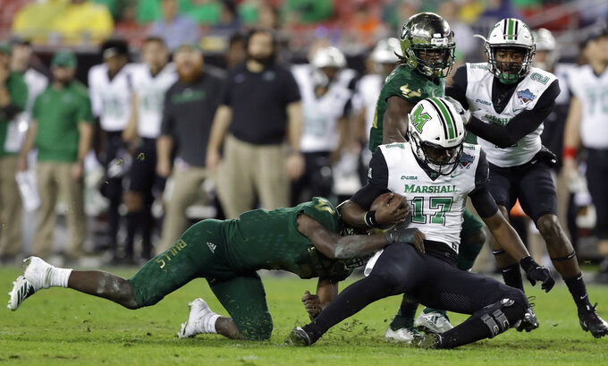 Marshall quarterback Isaiah Green (17) gets taken down by South Florida linebacker Khalid McGee during the second half of the Gasparilla Bowl NCAA college football game Thursday, Dec. 20, 2018, in Tampa, Fla. (AP Photo/Chris O'Meara)