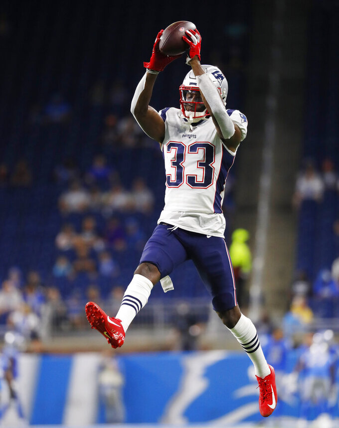 New England Patriots cornerback Joejuan Williams catches the ball as players warm up for an NFL football game against the Detroit Lions, Thursday, Aug. 8, 2019, in Detroit. (AP Photo/Paul Sancya)