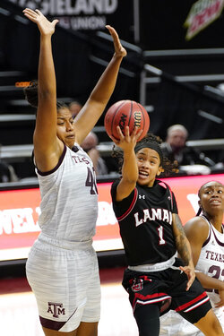 Lamar guard Jadyn Pimentel (1) shoots past Texas A&M center Ciera Johnson (40) during the first half of an NCAA college basketball game Wednesday, Nov. 25, 2020, in College Station, Texas. (AP Photo/Sam Craft)