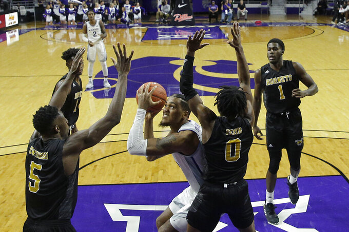 Kansas State's Levi Stockard III, center, looks to shoot past Alabama State's Tobi Ewuosho (5) and D.J. Heath (0) during the second half of an NCAA college basketball game Wednesday, Dec. 11, 2019, in Manhattan, Kan. (AP Photo/Charlie Riedel)